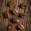 Coffee beans on wooden background — Zdjęcie stockowe
