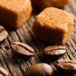 Coffee beans with brown sugar cubes — Stok fotoğraf