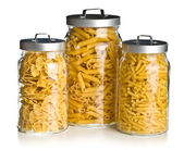 Various raw pasta in glass jar — Stock Photo