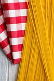 Spaghetti on kitchen table — Stock Photo