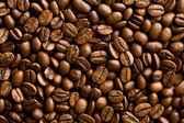 Pattern of coffee beans background — Stock Photo