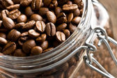 Coffee beans in glass jar — Stock Photo