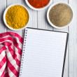 Various colored spices with blank recipe book — Foto de Stock