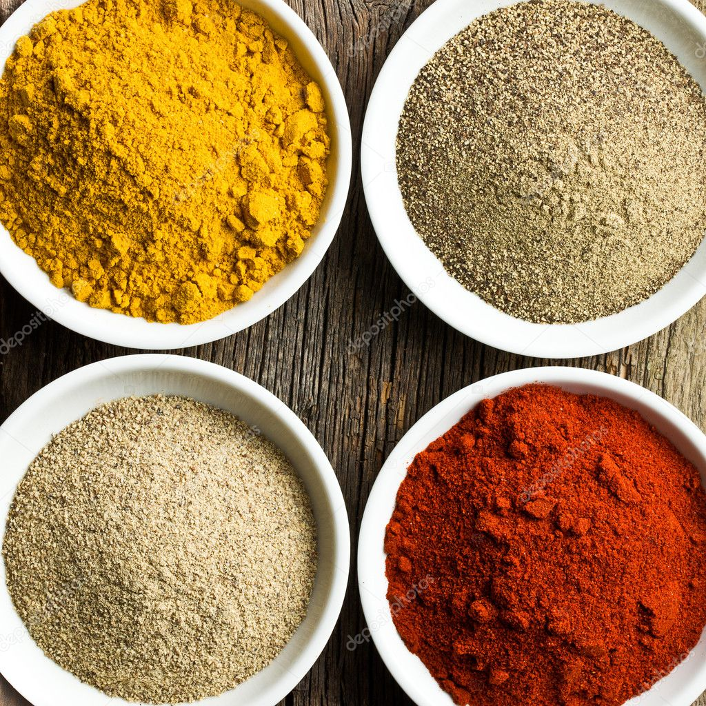 Various colored spices in ceramic bowls — Stock Photo #12389705