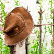 Bush hat on a railing with flowers — Stock Photo