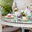 Afternoon tea and cakes in the garden - Stock Photo
