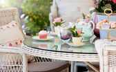 Afternoon tea and cakes in the garden — Stock Photo