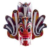 Beyaz arka plan üzerinde izole sri lankalı kırmızı kafa maskesi — Stok fotoğraf