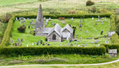 Small English church and grave yard — Stock Photo