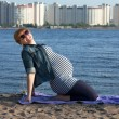 Pregnant womdoing gymnastic exercises — Photo #10784472
