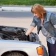 Pregnant Woman Trying to Repair the Car — Stock Photo