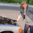 Pregnant Woman Trying to Repair the Car — Stock Photo #10784959