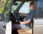 Pregnant woman at the wheel of car — Stock Photo