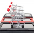 Stock Photo: Shopping Cart over a Tablet PC