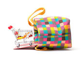 Shopping Cart with Vibrant Bag — Stock Photo
