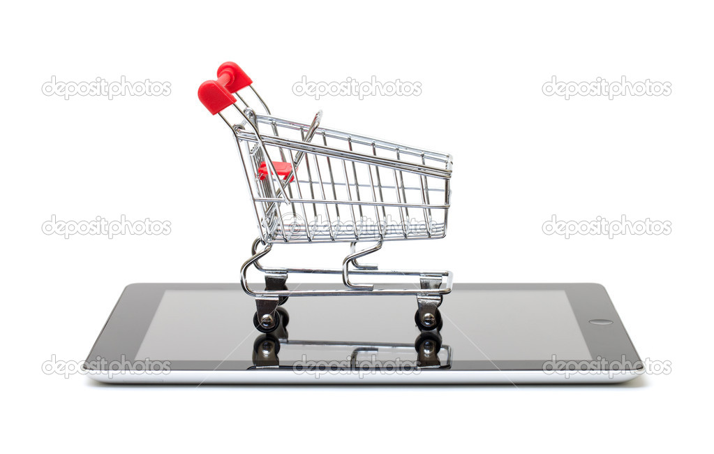 Shopping Cart over a Tablet PC on white background — Stock Photo #10934650