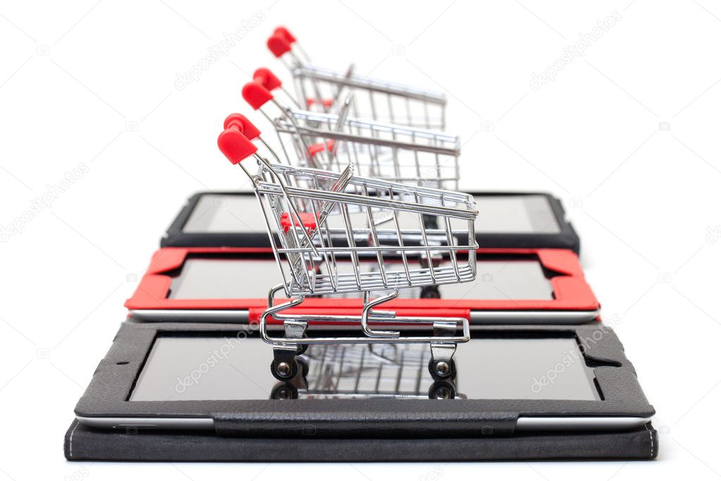 Shopping Cart over a Tablet PC on white background — Stock Photo #10934654