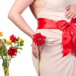 Stock Photo: Pregnant Woman with Flowers