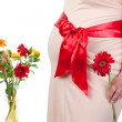 Pregnant Woman with Flowers — Stock Photo #11592040