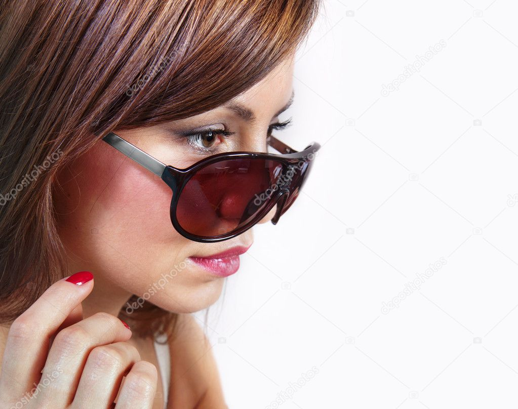 Portrait of lovely woman in shades over white — Stock Photo #10745783