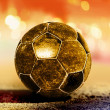 Golden ball on ground - Stock Photo