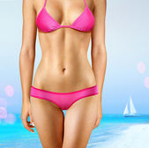 Woman in pink bathing suit — Stock Photo
