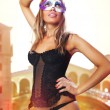 Sexual Venetian in carnival dress - Stock Photo