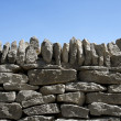 Dry-stone wall and blue sky — Stock Photo