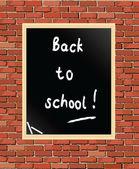 Chalkboard on brick wall — 图库矢量图片