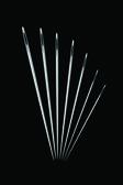 Needles on black — Stock Vector