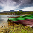 Boat at the Killarney lake in Co. Kerry - Stock Photo