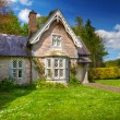 Stock Photo: Fairy tale cottage house