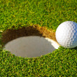 Golf ball near the hole — Stock Photo #10875562