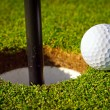 Golf ball near the hole — Stock Photo #10875583
