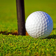 Golf ball near the hole — Stock Photo #10875601