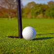 Golf ball near the hole — Stock Photo