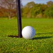 Stock Photo: Golf ball near the hole