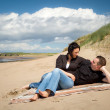 Couple together on the beach — Stock Photo #10875936