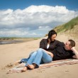 Couple together on the beach — Stock Photo