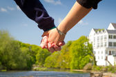 Holding hands together — Stock Photo