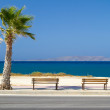 Benches at Aegean sea on Crete - Stock Photo