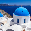 Blue churches of Santorini island - Stock Photo