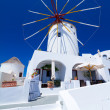 Windmill of Oia village at Santorini - Stock Photo