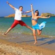 Happiness jump of young couple - Stock Photo