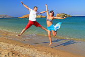 Happiness jump of young couple — Stock Photo