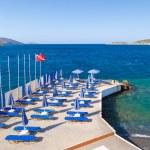 Blue deckchairsat Aegean Sea — Stock Photo #11645653