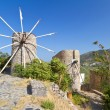 Ancient windmills of Lasithi Plateau - Stock Photo