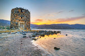 Old windmill ruin at Mirabello Bay — Stock Photo