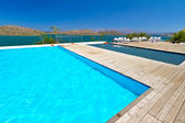 Swimming pool with idyllic view for Mirabello Bay — Stock Photo