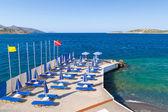 Blue deckchairsat Aegean Sea — Stock Photo